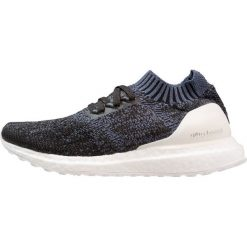 eb7cd7506b122d Niebieskie obuwie dziecięce marki adidas Performance - Kolekcja lato 2019.  Adidas Performance ULTRABOOST UNCAGED Obuwie do biegania treningowe tech  ink/core ...