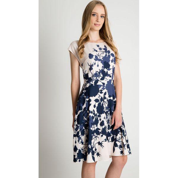 8d66b384c2 Wzorzysta sukienka ze zwiewnym dołem BIALCON - Sukienki damskie ...