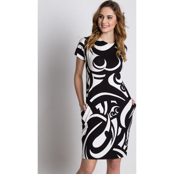 877c63c6cf Dzianinowa luźna sukienka z krótkim rękawem i kieszeniami BIALCON ...